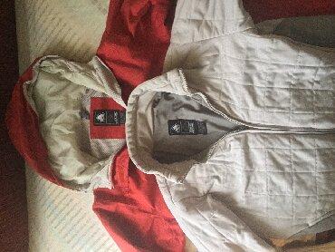 Zimske jakne modeli - Srbija: Muško ženska jakna orginal Nike veličine M model sa dve jakne
