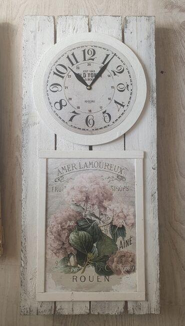 Kuća i bašta - Vrsac: Drveni zidni sat dimenzija 29×62.5 cm. Sat je nov sa besumnim