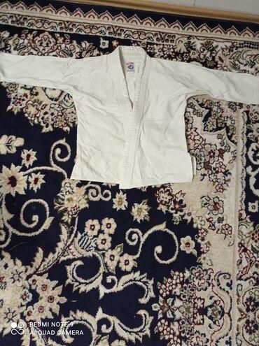 Продается кимоно 130 см.Хорошее качество. Носили два месяца .Вотсап +