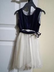Decije haljine   Lazarevac: Prelepa sljokicava haljinica teget bele boje, vel 80,samo jednom