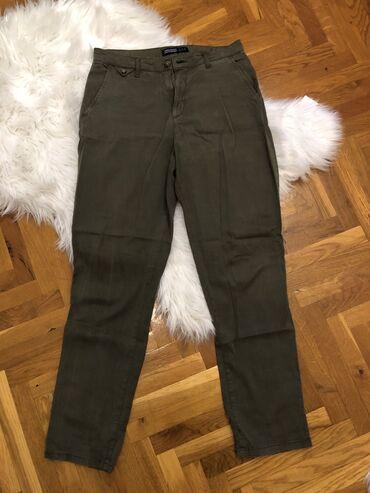 Maslinasto zelene zenske pantalone. ZARA. Velcina 36. Nove