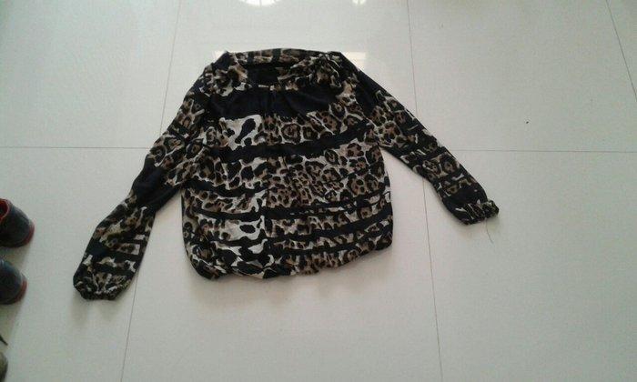 Košulje i bluze - Backa Palanka: Majica sa leopar printom detalj veze se sa strane oko vrata novo velicine m l xl