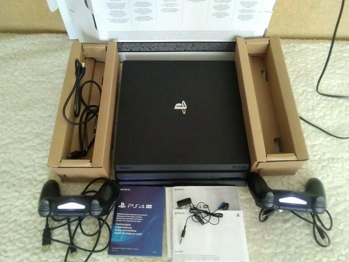 Playstation 4 pro 1tb με 2 joystick και 5 δωρεάν παιχνίδια της επιλογής σας