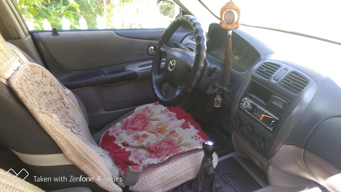 Mazda 323 2002. Photo 4