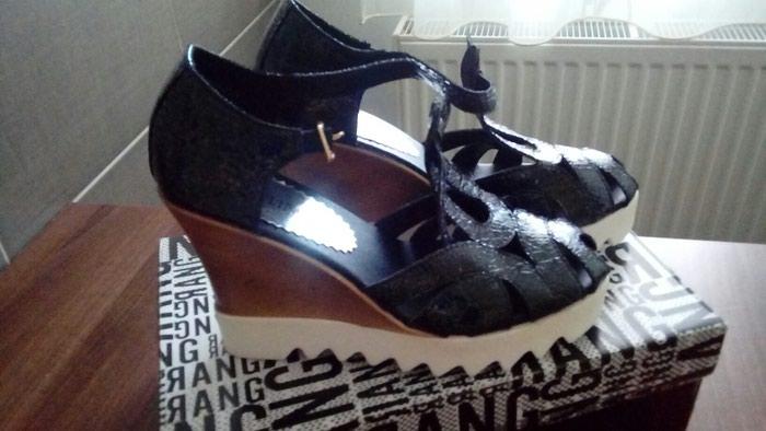 Sandale u broju 37. Nove ali imaju braon fleku na djonu. . Photo 0