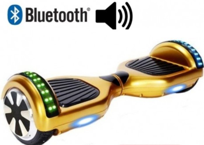 Unused gold hoverboard with led lights and bluetooth available with. Photo 0
