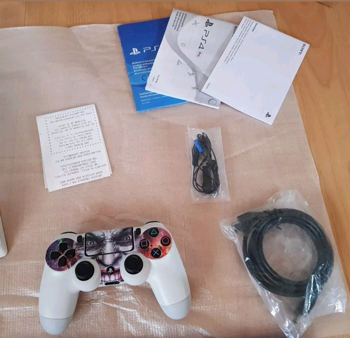 Sony PlayStation 4 pro 1TB with 2 controllers and 5 free games of your. Photo 3