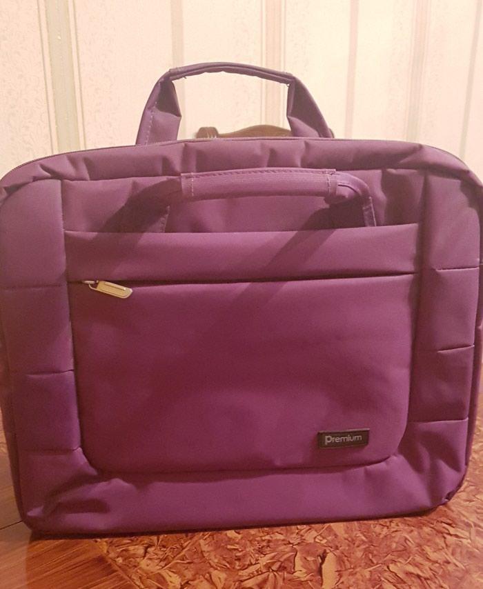 Bakı şəhərində Kompyuter (noutbuk)çantası.Az işlenib Benövşe reng.Qiymet:15 AzN