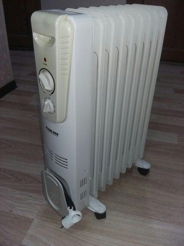NIKAI.Yağla işləyən elektrik radiatoru 8 sektiyalı super vəziyət. Photo 1