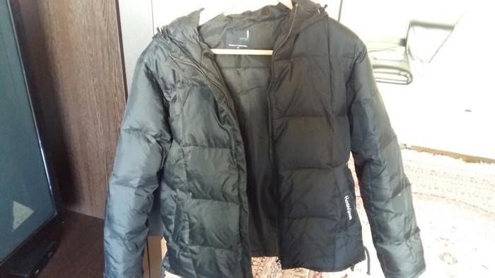 Черная зимняя женская куртка. Photo 0