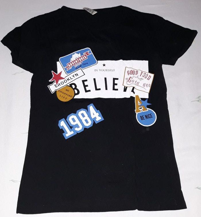 T-shirt μαύρο με σχέδια, νούμερο S.. Photo 0
