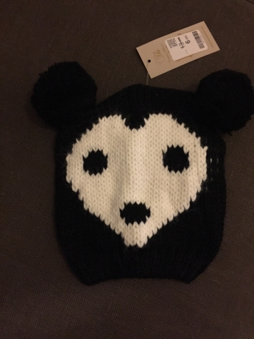 Children's wool cap with ready bear . New