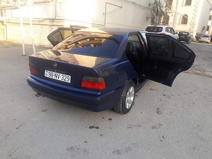 BMW 320 1994. Photo 6