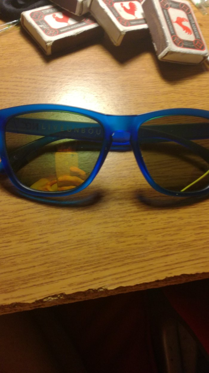 Blue sunglasses with golden lens. Case Included.. Photo 1