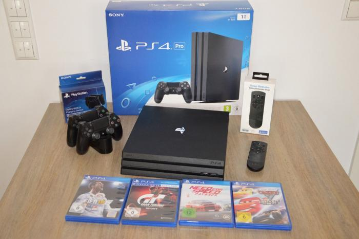 Playstation 4 Pro 1TB, With 2 Controllers and 4 Game Discs. Photo 0