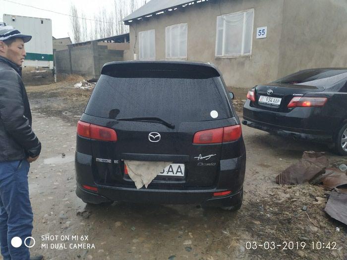Mazda Demio 2003. Photo 4