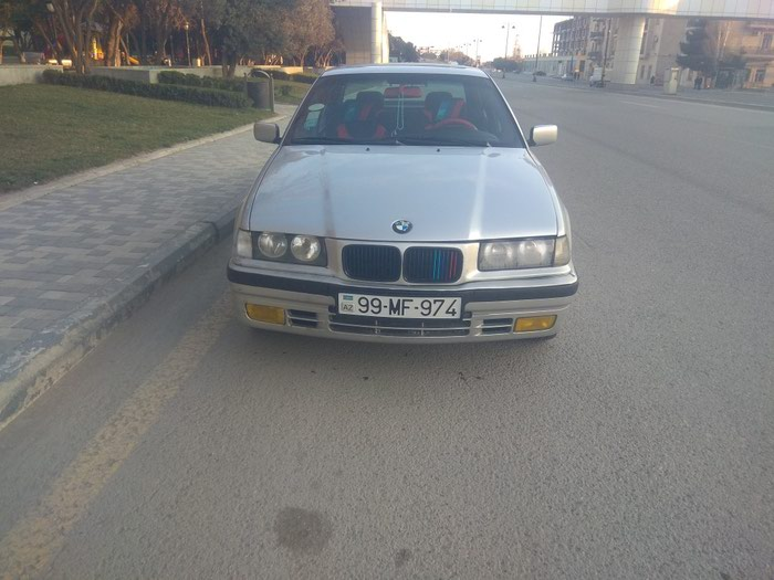 BMW 3 1994. Photo 1