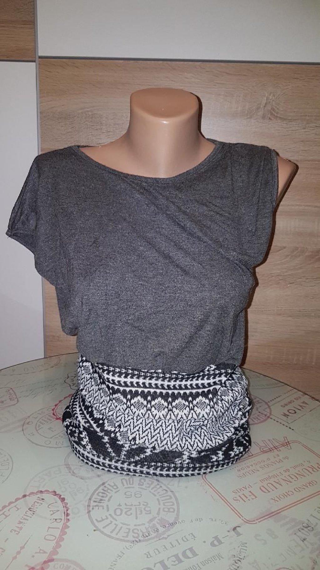 Haljina kvalitetna sa industrijskom trikotazom,pada na jedno rame,ubucena dva puta