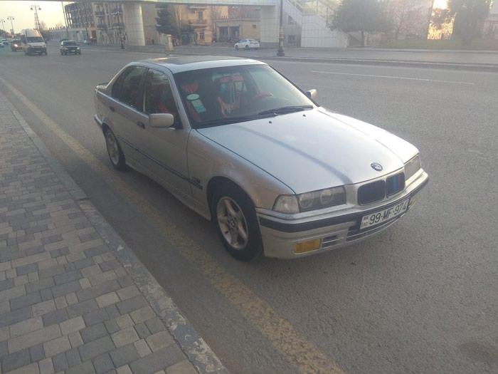 BMW 3 1994. Photo 0