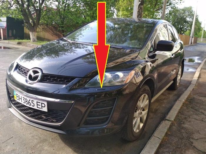 Крышка омывателя фар от Mazda CX-7.  В наличии только левая сторона.. Photo 1
