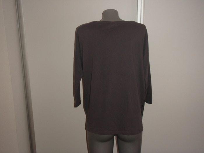 Majica OUTFIT 46 viskoza ramena 46 rukavi 42 grudi 65 duzina ledja 67. Photo 1