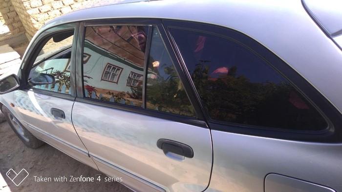Mazda 323 2002. Photo 2