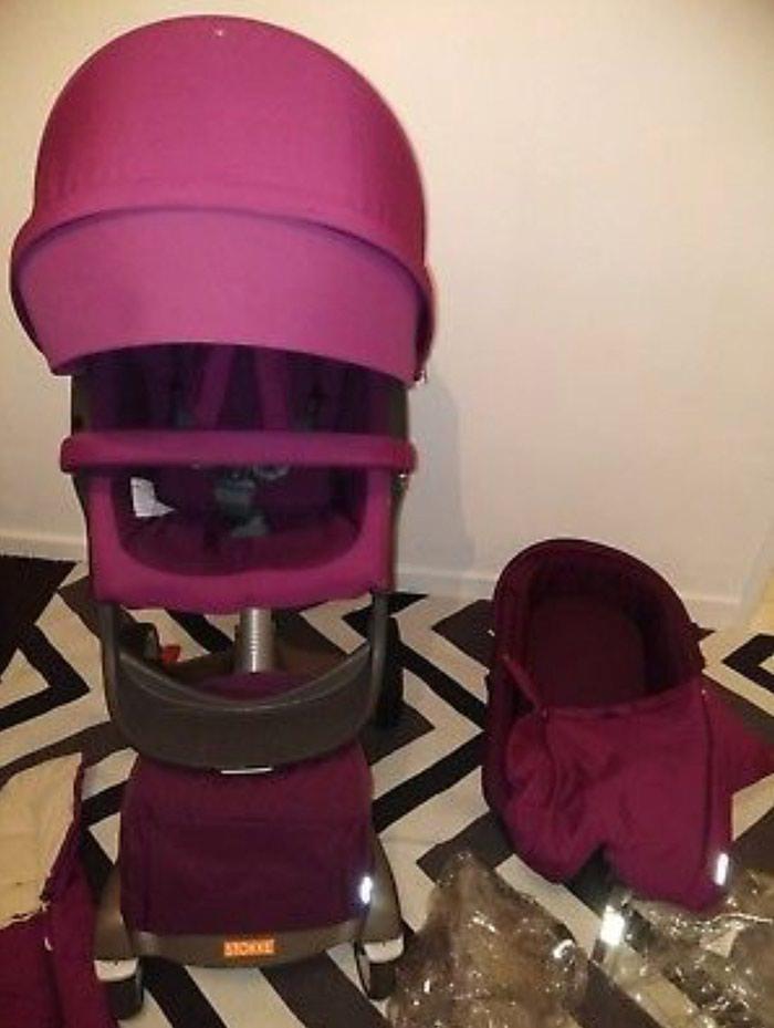 Stokke Xplory V4 Purple With Carry Cot , Seat Unit, Footmuff. Photo 8