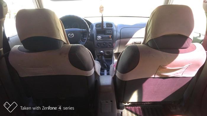 Mazda 323 2002. Photo 0