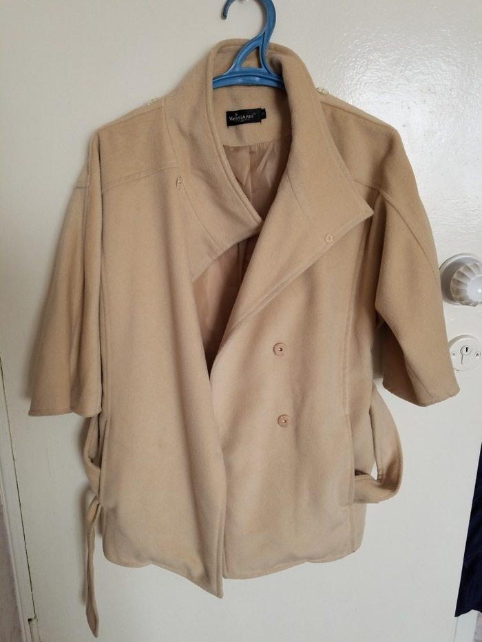 Продам весеннее пальто,размер s-ка,воротник снимается . Photo 1