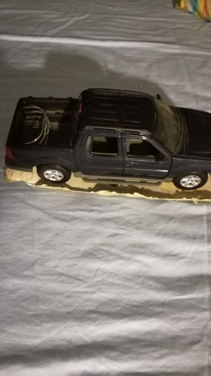 Ford Explorer toy car unboxed. Dark blue color