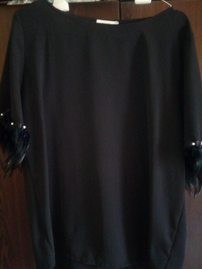 Μαύρη μπλούζα με φτερά κ πέρλες στα μανικια. Photo 1
