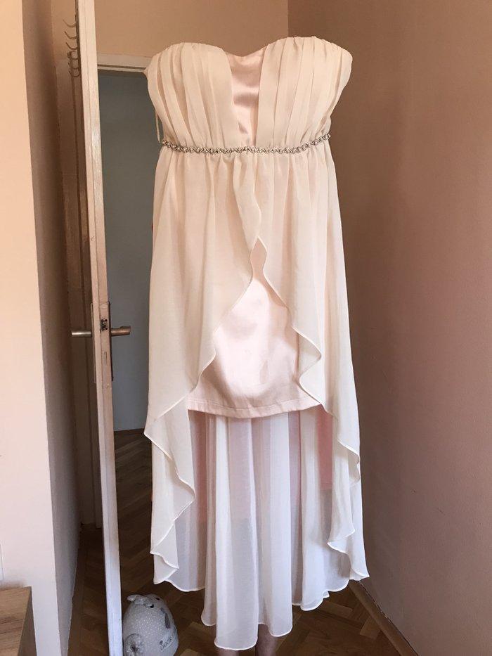 Svecana haljina, sa biserima oko struka sa prednje strane, deo za grudi je postavljen