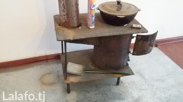 Печка новая для отопление и готовить так же есть много угля