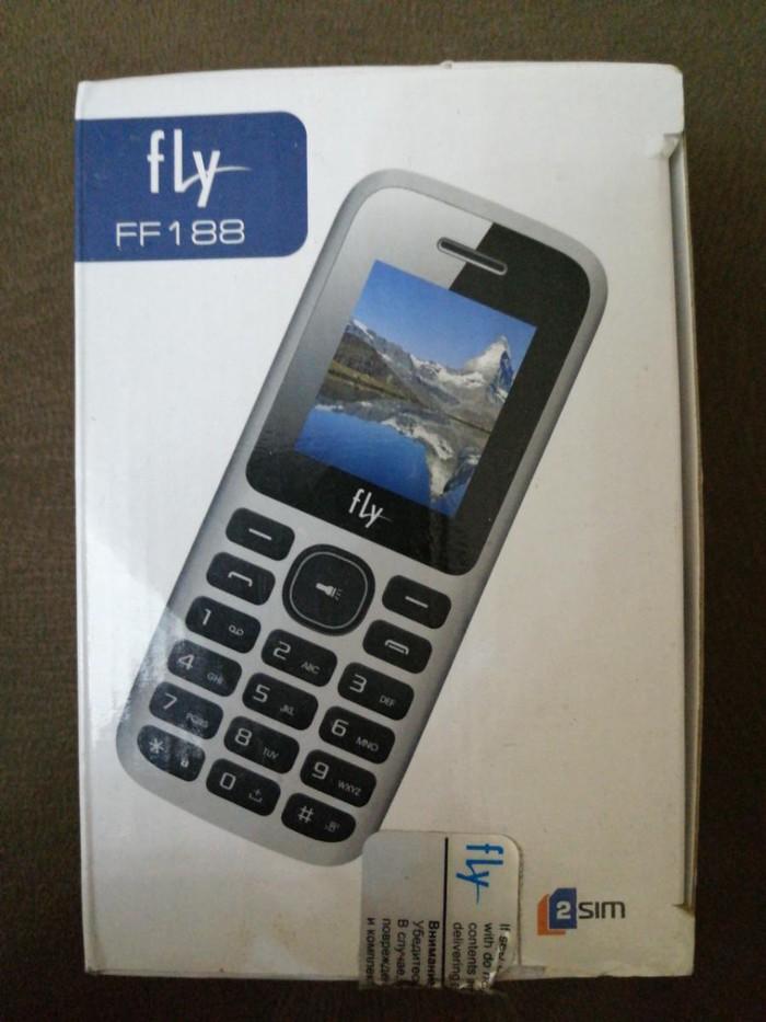 Fly ff188 Telefonun üzərində adaptor və karopka verilir в Хырдалан