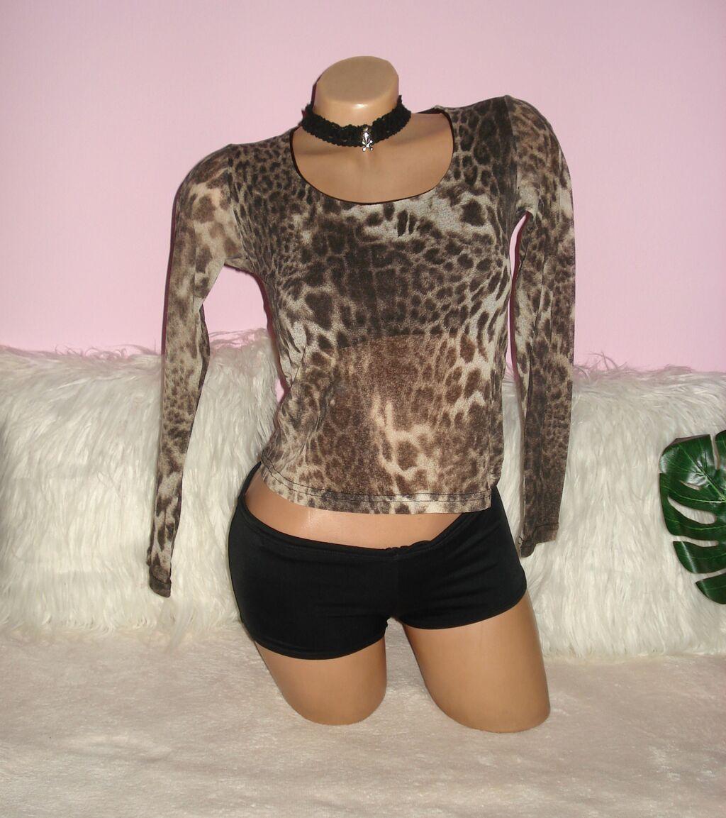 Animal print majica dugih rukava, blago prozirna osim u predelu grudi , velicina S
