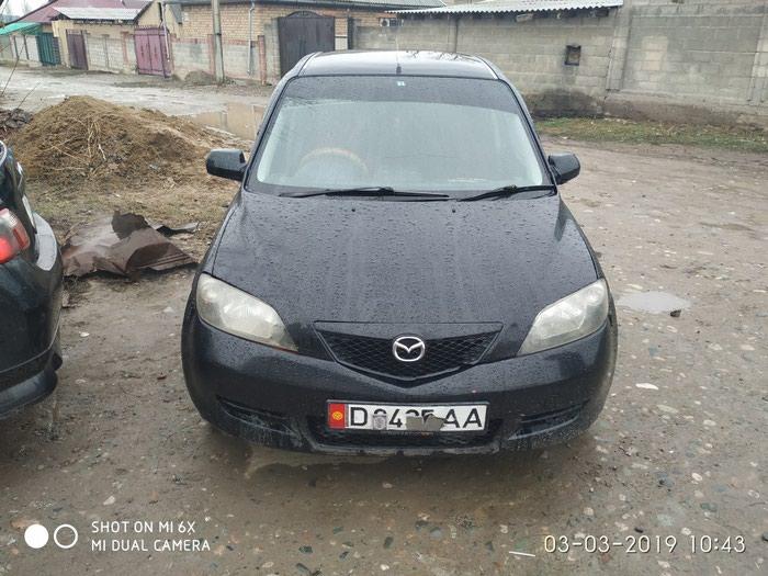 Mazda Demio 2003. Photo 3