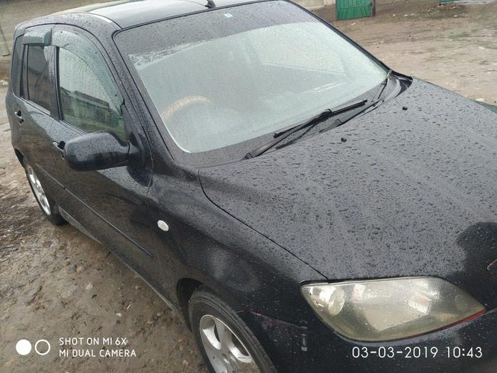 Mazda Demio 2003. Photo 0