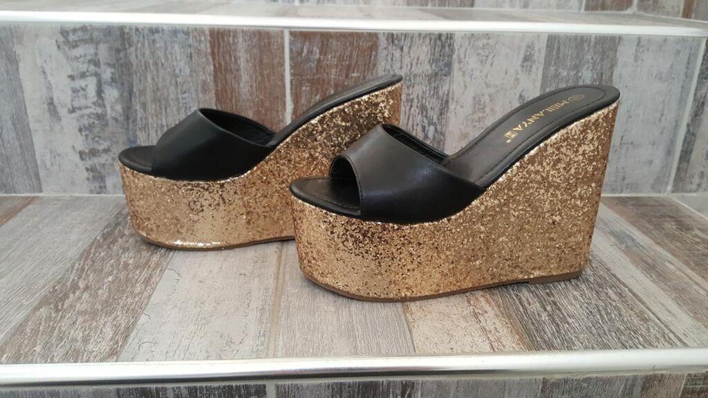 Nove nenosene papuce, velicina 38, gaziste 24cm, platforma napred 6,5cm, pozadi 13,5cm
