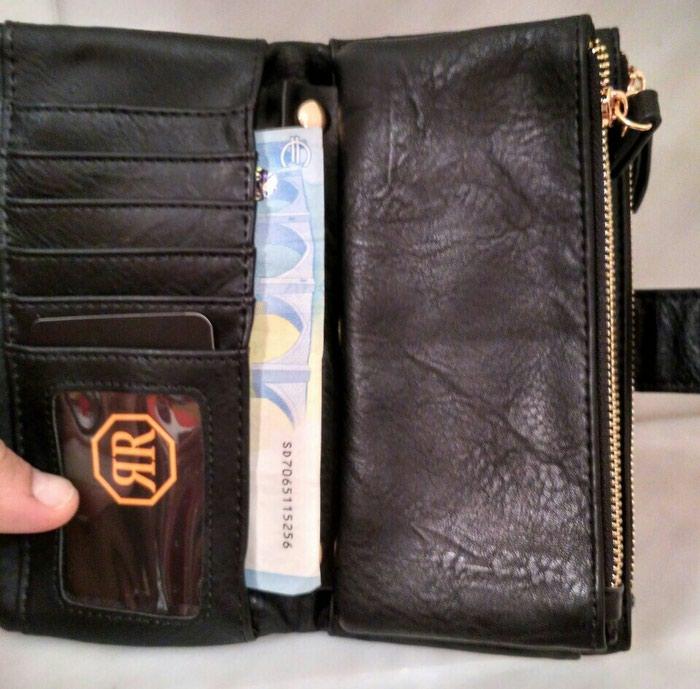Γυναικείο πορτοφόλι. Photo 1