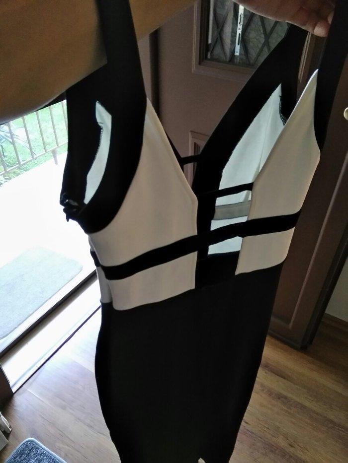 Φόρεμα γυναικείο  μαύρο small midi. Photo 1