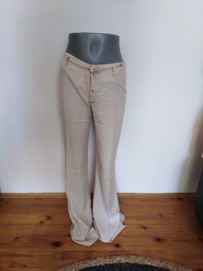 Lanene pantalone, br 38.Boja bele kafe. Moguća dostava u Bg - u