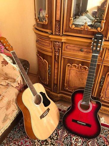 Bakı şəhərində Akustik gitara rivertone 10 gundu almiwam cizigi bele yoxdu, ustunde