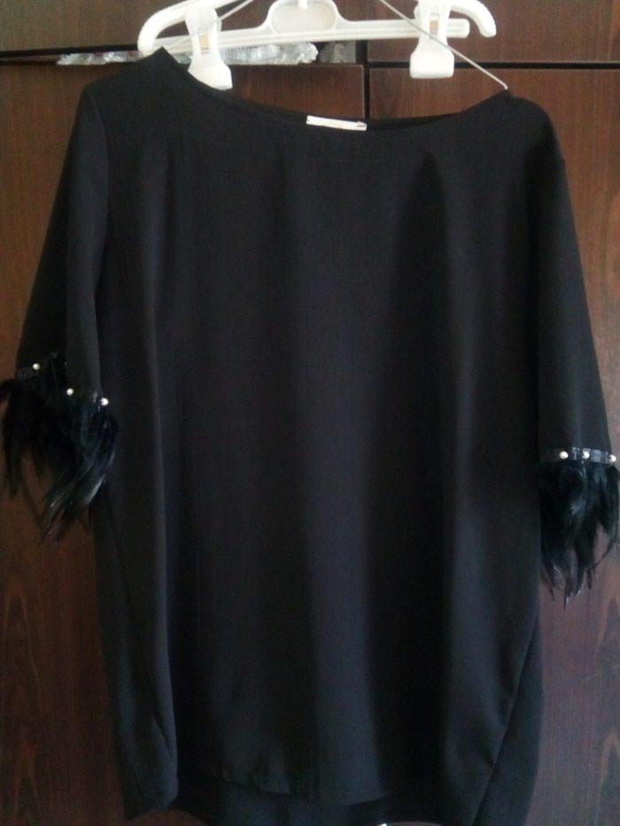 Μαύρη μπλούζα με φτερά κ πέρλες στα μανικια. Photo 0