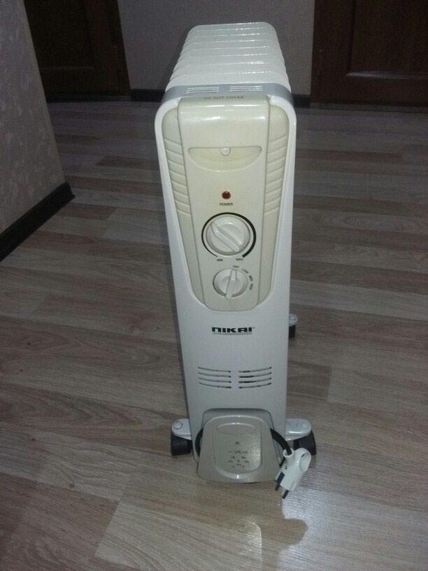 NIKAI.Yağla işləyən elektrik radiatoru 8 sektiyalı super vəziyət. Photo 3
