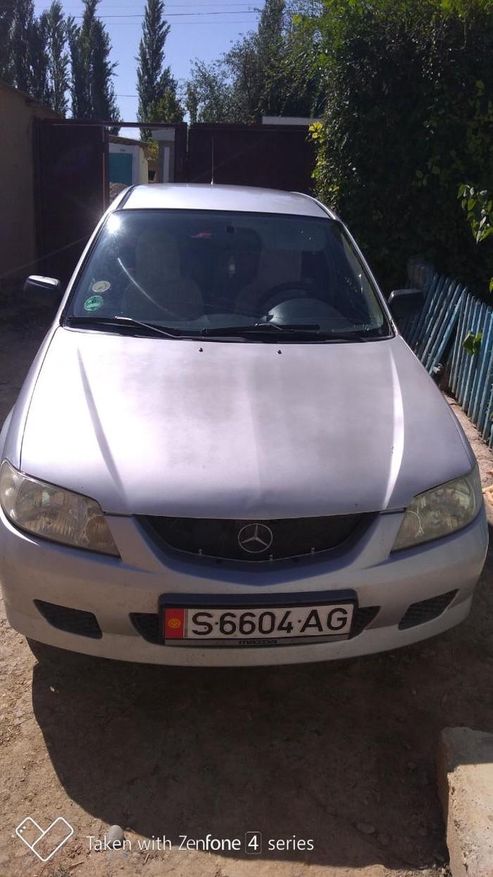 Mazda 323 2002. Photo 5