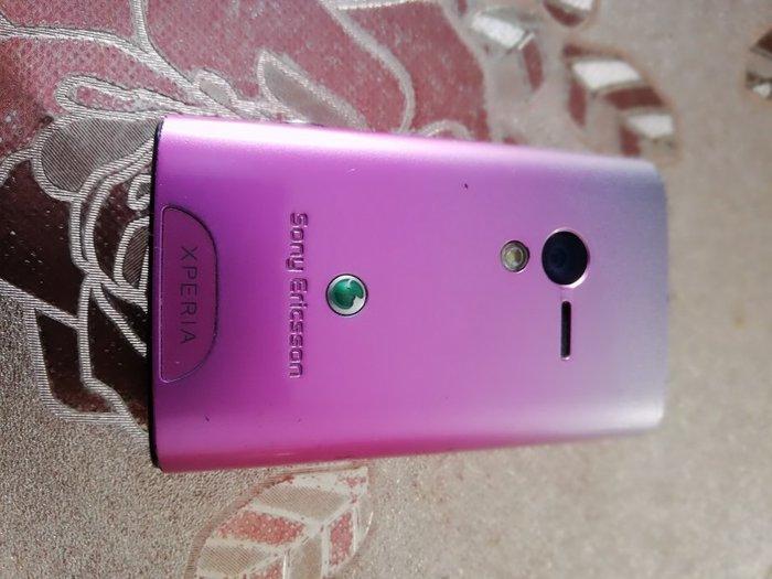 Λειτουργικο μικρό κομψό κινητό σε ροζ χρώμα. Photo 1