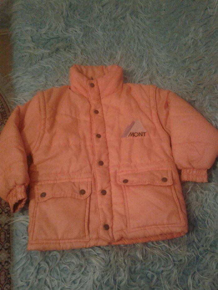 Decija zimska jakna odlicno ocuvana. Narandzaste boje