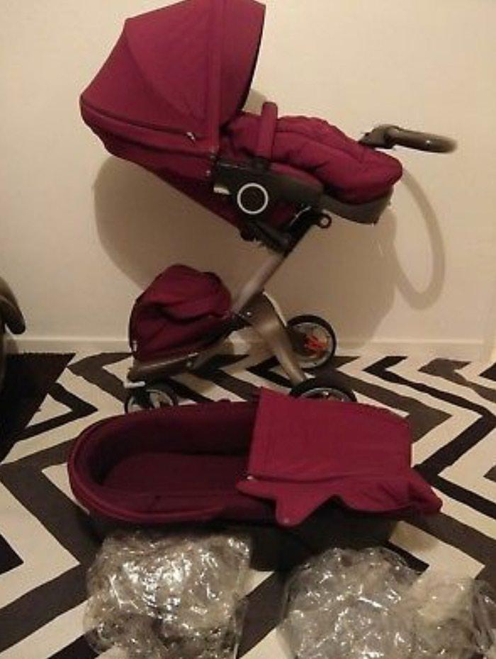 Stokke Xplory V4 Purple With Carry Cot , Seat Unit, Footmuff. Photo 7