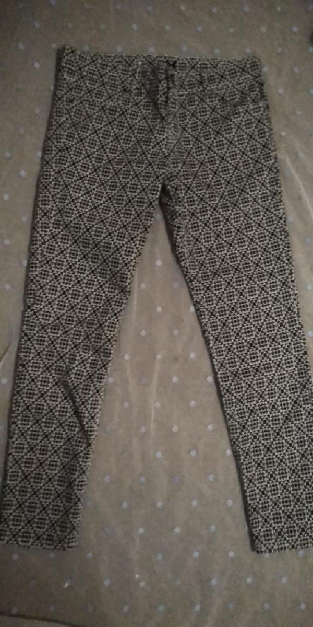 Crno-bele pantalone sa interesantnom sarom br. 36
