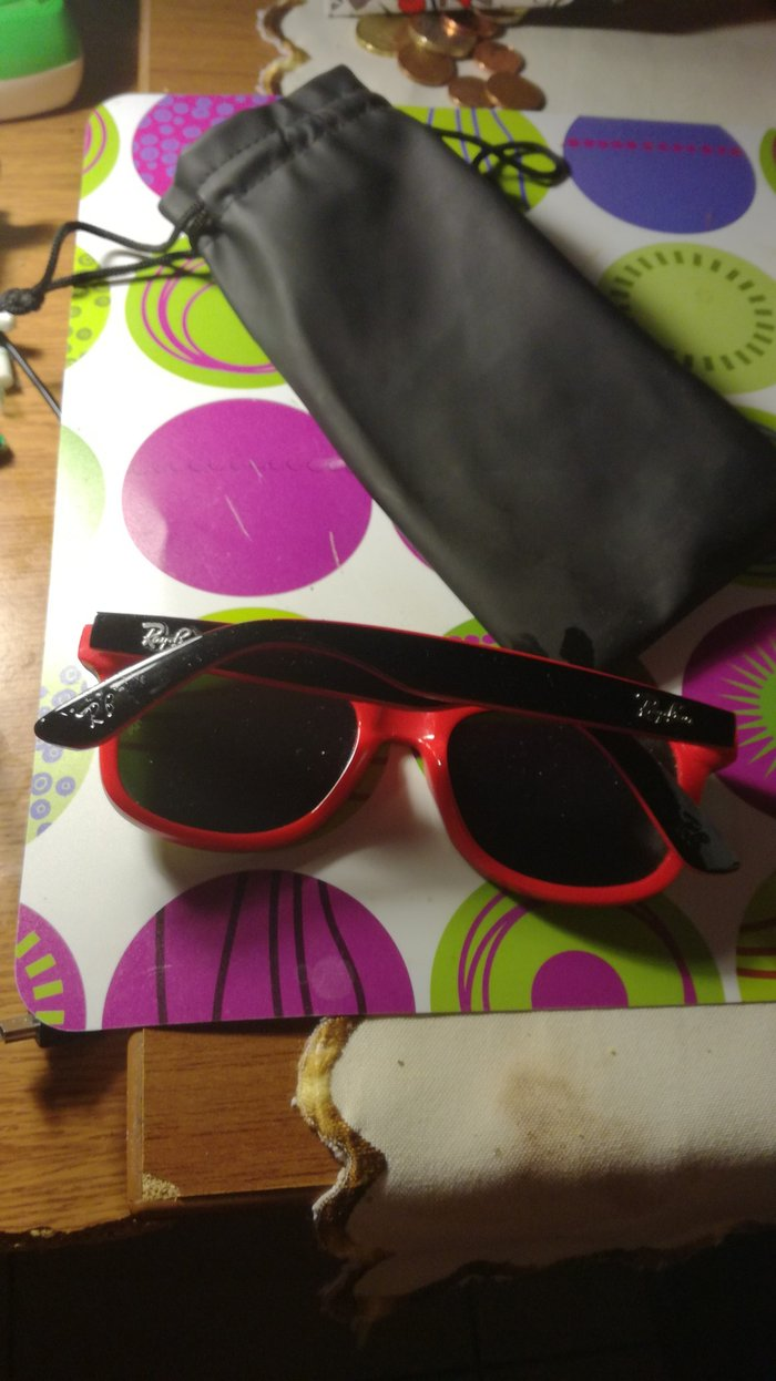 Red sunglasses with yellow lens. Case included.. Photo 1